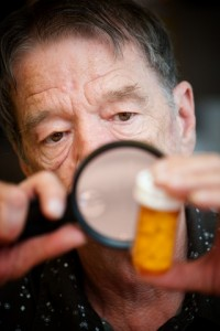 Man Examining Medication Bottle