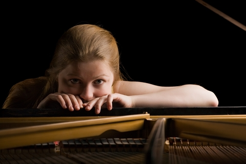 Woman by Piano