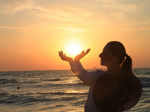 Woman Holding the Sunrise